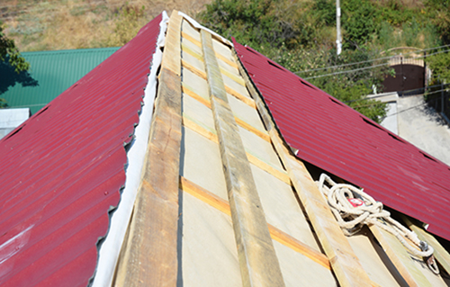 Roofing Contractors Installing House Metal Sheets Roof